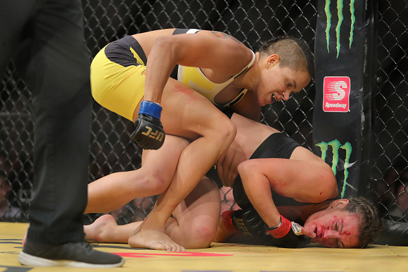 LAS VEGAS, NV - JULY 9: Amanda Nunes punches Miesha Tate (R) during the UFC 200 event at T-Mobile Arena on July 9, 2016 in Las Vegas, Nevada. (Photo by Rey Del Rio/Getty Images)