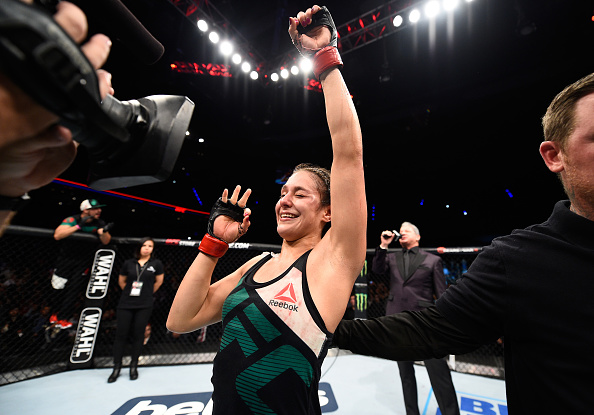 MEXICO CITY, MEXICO - NOVEMBER 05:  Alexa Grasso of Mexico celebrates her victory over Heather Jo Clark of the United States in their women's strawweight bout during the UFC Fight Night event at Arena Ciudad de Mexico on November 5, 2016 in Mexico City, Mexico. (Photo by Jeff Bottari/Zuffa LLC/Zuffa LLC via Getty Images)